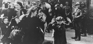 ** FILE ** In this April 19, 1943 file photo, a group of Jews, including a small boy, is escorted from the Warsaw Ghetto by German soldiers. The family of a Polish social worker Irena Sendler who is credited with rescuing 2,500 Jewish children from the Nazis during the Holocaust says she has died. Sendler's daughter, Janina Zgrzembska, says her 98-year-old mother died Monday, May 12, 2008, morning in a Warsaw hospital. Sendler organized the rescue of Jewish children from the Warsaw Ghetto during Nazi Germany's brutal World War II occupation. (AP Photo)/Poland_Obit_Sendler_FRA110/FILER, B/W ONLY/0805121107