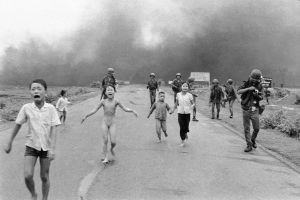 South Vietnamese forces follow after terrified children, including 9-year-old Kim Phuc, center, as they run down Route 1 near Trang Bang after an aerial napalm attack on suspected Viet Cong hiding places, June 8, 1972. A South Vietnamese plane accidentally dropped its flaming napalm on South Vietnamese troops and civilians. The terrified girl had ripped off her burning clothes while fleeing. The children from left to right are: Phan Thanh Tam, younger brother of Kim Phuc, who lost an eye, Phan Thanh Phouc, youngest brother of Kim Phuc, Kim Phuc, and Kim's cousins Ho Van Bon, and Ho Thi Ting. Behind them are soldiers of the Vietnam Army 25th Division. (AP Photo/Nick Ut)/APHS021000/AP_72060801062/1973 PULITZER PRIZE WINNER THIS IMAGE IS AVAILABLE AT HIGHER RESOLUTIONS. CONTACT YOUR AP IMAGES REPRESENTATIVE./1601251629