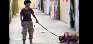 ** FILE ** An undated photo obtained by the Washington Post and released Thursday, May 6, 2004, shows a soldier, identifed as Army Reserve Pfc. Lynndie England, of the 372nd Military Police Company, holding a leash connected to a naked detainee at the Abu Ghraib prison in Baghdad. England, 21, was charged Friday, MAY 7, 2004, by the military with assaulting the detainees and conspiring to mistreat them. She faces four allegations, according to a statement from the XVIII Airborne Corps at Fort Bragg. (AP Photo/The Washington Post, File) ** MANDATORY CREDIT TO THE WASHINGTON POST, INTERNET OUT, WASHINGTON TIMES OUT, NEW YORK TIMES OUT, USA TODAY OUT, NO SALES **/PRISONER_ABUSE_ENGLAND_DCWAP201/MANDATORY CREDIT TO THE WASHINGTON POST, INTERNET OUT, WASHINGTON TIMES OUT, NEW YORK TIMES OUT, USA TODAY OUT, NO SALES/0405080208